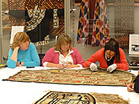 Beth Robertson, Suzanne Howren and Meghann O'Brien in the archives of MOA